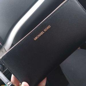 Brand New Michael Kors wallet/Travel hand bag